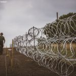 Members of the Hungarian Defence Force install barbed wire on th